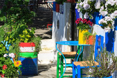 Colourful handmade garden furniture. Stay among flower and green vegetation Royalty Free Stock Photography