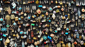 Jewelry hand make. Colourful handmade jewlery of street seller Stock Images