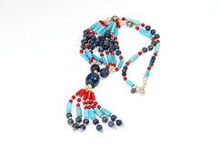 Colourful handmade necklace. Close-up on very colourful handmade necklaces isolated by white background royalty free stock image