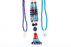 Colourful handmade necklaces. Close-up on very colourful handmade necklaces isolated by white background royalty free stock image
