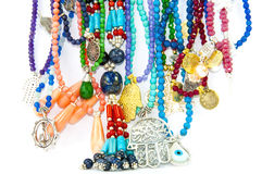 Colourful handmade necklaces. Close-up on very colourful handmade necklaces isolated by white background royalty free stock photo