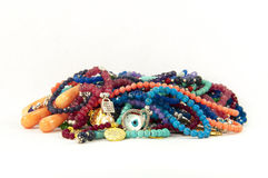 Colourful handmade necklaces. Close-up on very colourful handmade necklaces isolated by white background stock photography