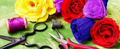 Colourful handmade paper flowers. Paper craft and tools stock photo