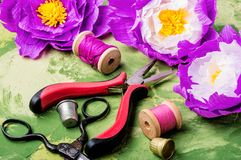 Colourful handmade paper flowers. Paper craft and tools royalty free stock photo