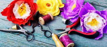 Colourful handmade paper flowers. Paper craft and tools stock images