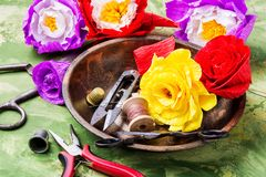 Colourful handmade paper flowers. Paper craft and tools.Hobby royalty free stock photo