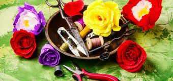 Colourful handmade paper flowers. Paper craft and tools royalty free stock photography