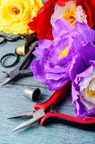 Colourful handmade paper flowers. Paper craft and tools royalty free stock photos