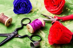 Colourful handmade paper flowers. Paper craft and tools stock photography