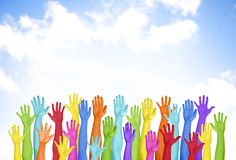 Colourful Hands Raised With Blue Sky Royalty Free Stock Image