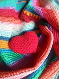 Colourful happy hearts. Red  heart on colourful stripe shawl freshen the merry day Stock Photo