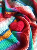 Colourful happy hearts. Red  heart on colourful stripe shawl freshen the merry day Stock Photography
