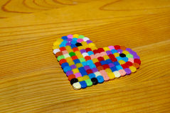 COLOURFUL HEART OF BEADS Stock Photography