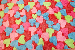 Colourful heart. Many colourful heart on the fabric Royalty Free Stock Images