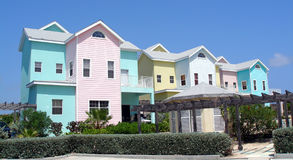 Colourful homes on Grand Cayman. Beautiful and colourful beachfront homes on the Caribbean island of Grand Cayman Stock Images