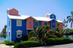 Colourful homes on Grand Cayman. Beautiful and colourful beachfront homes on the Caribbean island of Grand Cayman Royalty Free Stock Photo