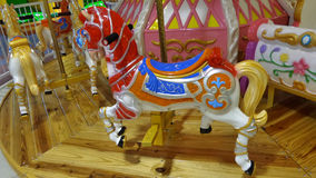 Colourful horses on Merry Go Round Royalty Free Stock Image