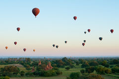 Colourful hot air balloons float over Bagan Temples. Royalty Free Stock Photo