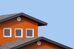Colourful house and blue sky. Detail of the rooftops of the typical wooden houses of Iles de la Madeleine, or the Magdalen Islands, in Canada. Minimalistic style royalty free stock images