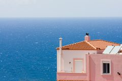 Colourful house by ocean Royalty Free Stock Photo