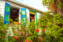 Colourful house in a tropical garden Stock Images