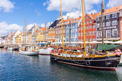 Colourful houses and boats Nyhavn Copenhagen. Nyhavn canal tourists and restaurants boats Royalty Free Stock Photo