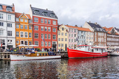 Colourful houses and boats in Nyhavn Copenhagen. Houses and boats reflecting in the water Royalty Free Stock Photo