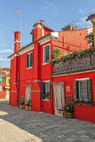 A colorful red house in Burano Royalty Free Stock Image