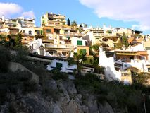 Colourful houses a hillside. Beautiful spanish houses on a hillside overlooking the sea Stock Photos