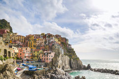 Colourful houses of Manarola, UNESCO World Heritage Site, suspended between sea and land on sheer cliffs, Cinque Terre, Italy Royalty Free Stock Photography