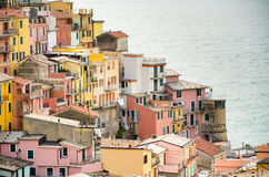 Colourful houses of Manarola, UNESCO World Heritage Site, suspended between sea and land on sheer cliffs, Cinque Terre, Italy Royalty Free Stock Photos