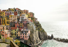 Colourful houses of Manarola, UNESCO World Heritage Site, suspended between sea and land on sheer cliffs, Cinque Terre, Italy Royalty Free Stock Images