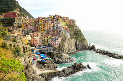 Colourful houses of Manarola, UNESCO World Heritage Site, suspended between sea and land on sheer cliffs, Cinque Terre, Italy Stock Photos