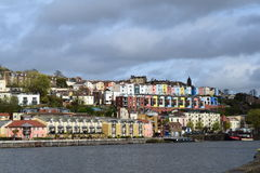 Colourful houses overlooking the river Avon in Bristol. Brightly painted houses and buildings that overlook the Avon river docks and wharfs Royalty Free Stock Image