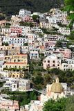 Positano houses vert. The colourful houses of Positano stacked on a precipitous hillside, Italy stock images