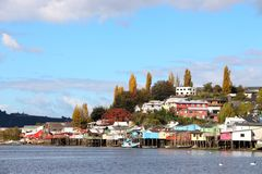 The Colourful Houses on stilts of Chiloe. Typical architecture stilts in Castro, Big Island of Chiloe. Chile Stock Photo