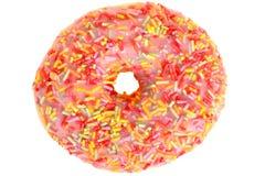 Colourful Iced Donut Desert covered in sprinkles Stock Image