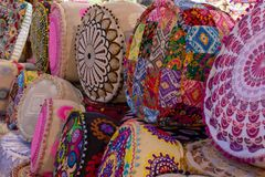 Colourful Indian Pillows lines up for sale in at Global Village Market in Dubai, United Arab Emirates stock photography