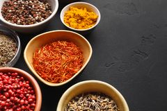 Colourful indian spices in bowls on background stock photo