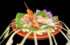 Colourful indonesian dish. Ornamented colorful indonesian dish in black back royalty free stock images
