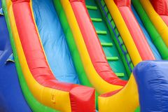 A colourful inflatable slide at a carnival. A colourful inflatable slide at a sideshow carnival Royalty Free Stock Photography