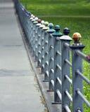 Colourful iron fence Stock Photos