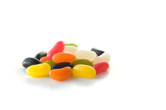 Colourful jelly beans. Studio image of colourful jelly beans on white background. Copy space royalty free stock image