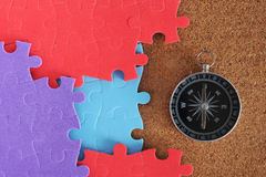 Colourful jigsaw puzzle. With compass Royalty Free Stock Images