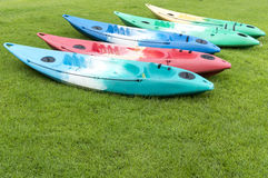 Colourful kayak on green grass Stock Image
