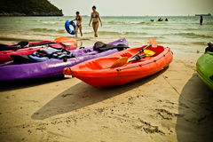 Colourful kayaks on the beach. Stock Photo