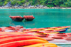Colourful kayaks and boats on tropical island Royalty Free Stock Photography