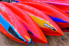 Colourful Kayaks. Brightly colored Kayaks at palm cove beach, Australia stock image