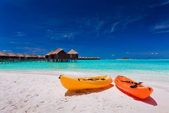 Colourful kayaks on the tropical beach Stock Photos
