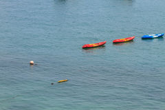 Colourful kayaks on tropical sea Royalty Free Stock Image